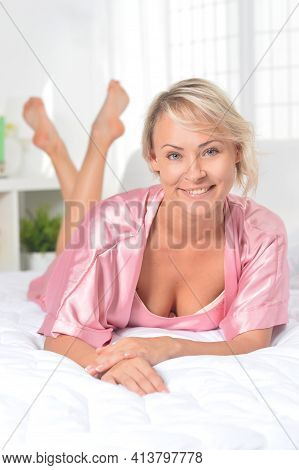 Beautiful Young Woman Awaking On Soft Bed On Morning