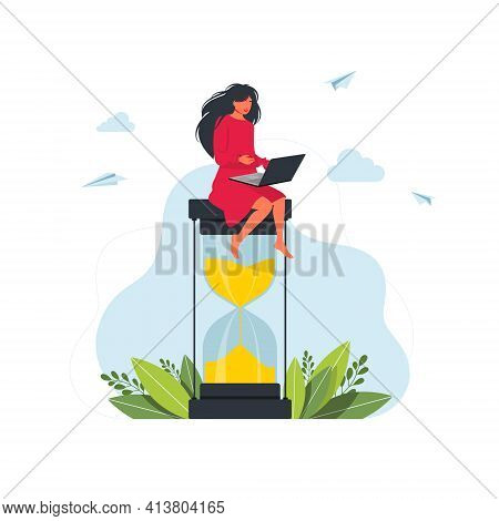 Attractive Woman Working On Laptop While Sitting On Hourglass Time Management Concept. Multitasking,