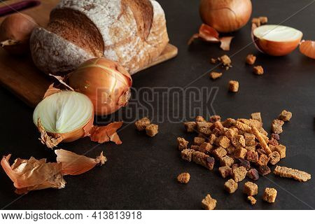 Cooking Homemade Croutons From Bread, Croutons With Onions In A Close-up On A Dark Background, Still
