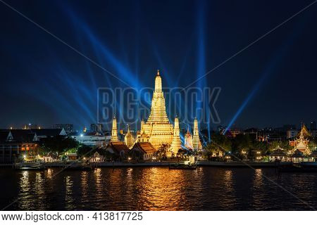 Temple Of Dawn Or Wat Arun With Laser Lights Show With Chao Phraya River, Bangkok, Thailand In Ratta