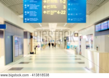 Airport Background. Defocused Blurred Transition Between Gates And Terminals Inside A Modern Airport
