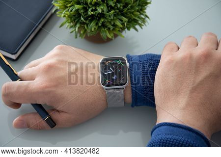 Anapa, Russia - November 3, 2018: Man Hand With Apple Watch Series And Finger Touching Screen. Apple