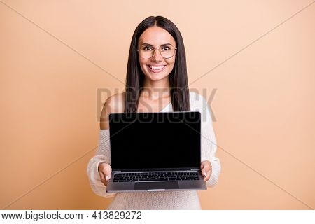 Photo Of Young Cheerful Woman Present Show Laptop Recommend Advert Isolated Over Beige Color Backgro