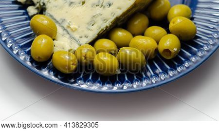 Pickled Olives Stuffed Garlic With Full Fat Soft Blue Veined Cheese On The Blue Plate