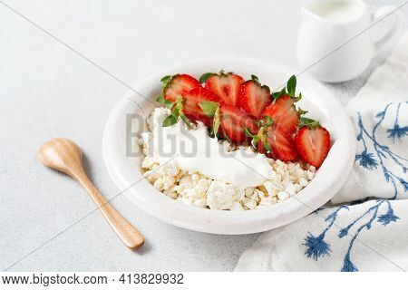 Cottage Cheese, Curd Cheese With Strawberries Berries In A Bowl, Ogranic Homemade Dairy Product. Hea
