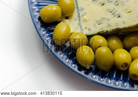 Pickled Olives Stuffed Garlic With Full Fat Soft Blue Veined Cheese On The Blue Plate, Tasty Appetiz