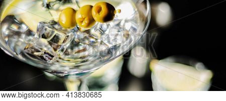 Traditional Drink Based On Gin And Vermouth With Olives And Ice Cubes In A Cocktail Glass, Nightlife