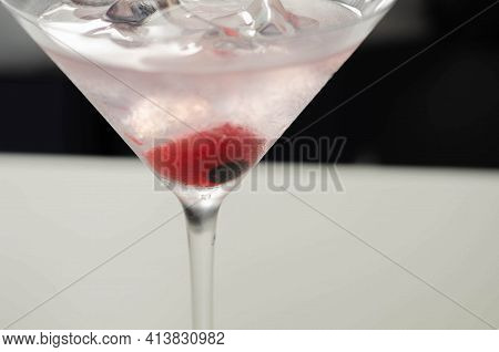 Halloween Drink In A Martini Glass Based On Vodka, Cream Liqueur And Grenadine With An Edible Decora