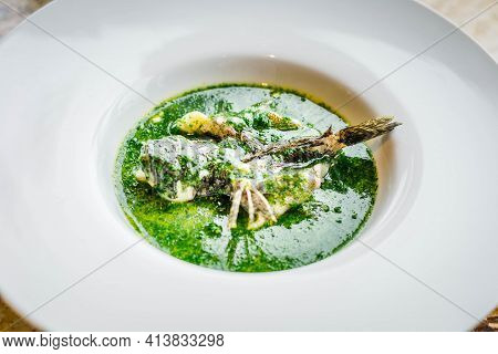 Main Course Of Odontobutis Obscurus Fish And Farm Egg Stewed And Served On A Plate