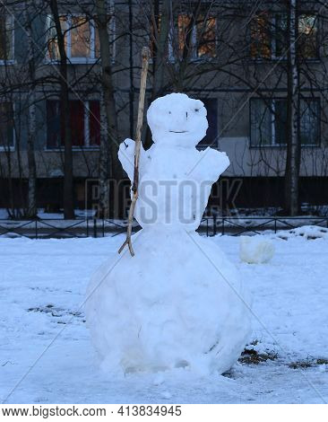 Snowman In The Courtyard Of A Residential Building