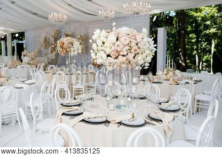Festive Wedding Table Setting With Flowers, Napkins, Cutlery, Glasses, Bright Summer Table Decor. We