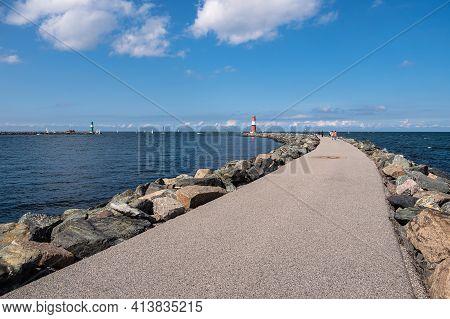 Mole On The Baltic Sea Coast In Warnemuende, Germany.