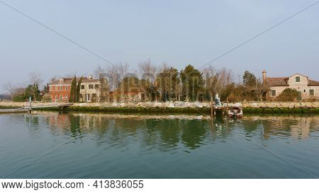 Venice, Italy - February 2020. A Small Green Island Not Far From The Famous City. A Local Resident M