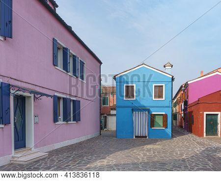 Venice, Italy - February 2020. Old Buildings Painted In Bright Colors Create A Summer Mood.