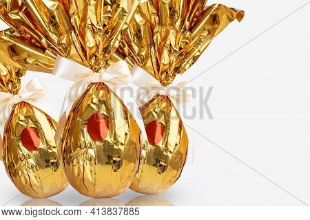 Brazilian Easter Egg, Wrapped In Golden Yellow Paper, On White Background