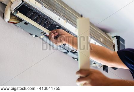 Air Conditioning Repair, Repairman Fixing Air Conditioning System, Male Technician Service For Repai