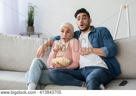 Shocked Muslim Couple Watching Thriller On Tv