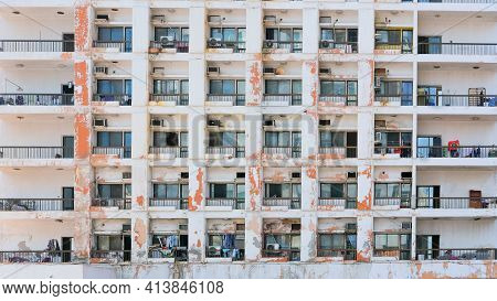 Facade Of Inadequate Tenement Slum With Low-cost Living. Forced Eviction, Homelessness,urban Slum Dw
