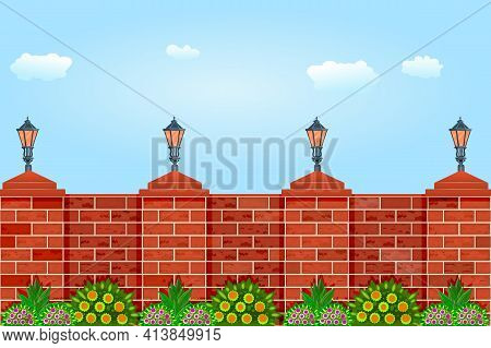 Brick Fence Against The Sky. Fence With Pillars Of Bricks, Street Lamps, Green Plants And Blue Sky.