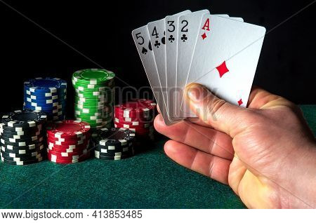 Poker Cards With The High Card Or Senior Ace Combination. Close-up Of A Gambler Hand Is Holding Play