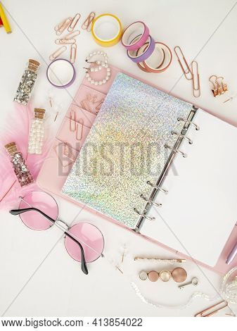Diary Opens With White And Holographic Page. Pink Planner With Cute Stationery Photographing In Flat