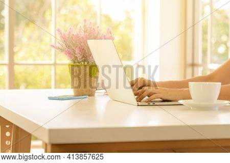 Close Up Hand Of Woman Working With Laptop Computer In Living Room At Home. Work At Home Concept