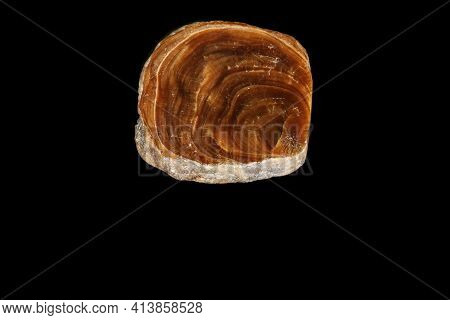 Macro Onyx Mineral Stone On A Black Background Close Up