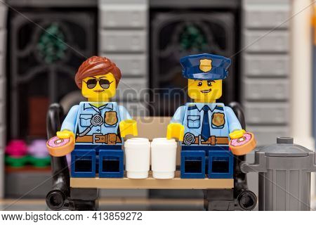 Tambov, Russian Federation - March 19, 2021 Lego Policeman And Policewoman Minifigures Sitting On A