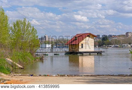 Floating Pontoon With Wooden House At Sava River