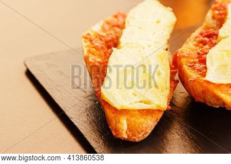 Potato Omelette Skewer With Bread With Tomato. Typical Spanish Food. Horizontal Image.