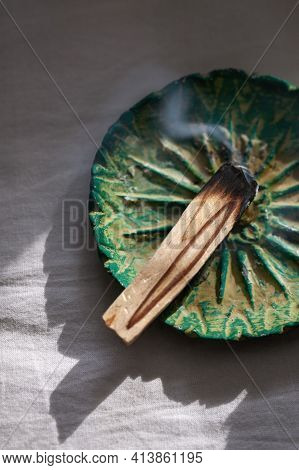 Burning Palo Santo Stick On Ceramic Plate. Antistress And Relaxation Ritual Concept