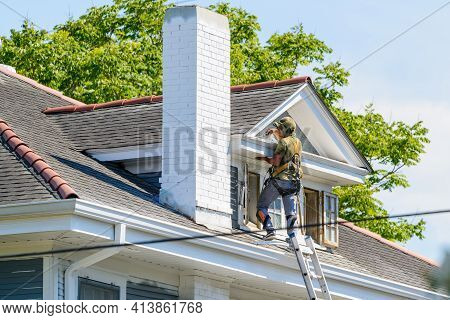 New Orleans, La - June 17: Painter Works On Third Story Of House Next To Ladder On June 17, 2020 In