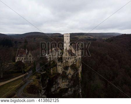 Aerial Panorama View Of Medieval Schloss Lichtenstein Castle On Hill Cliff Edge In Echaz Valley Hona