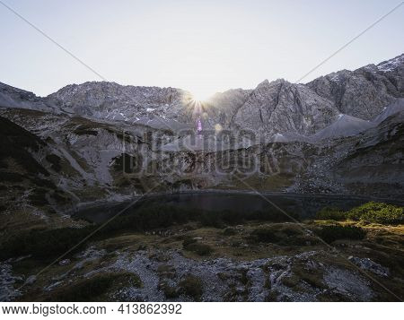 Sunset Panorama Of Rocky Mountain Massif With Calm Alpine Lake Drachensee In Ehrwald Tyrol Austria A