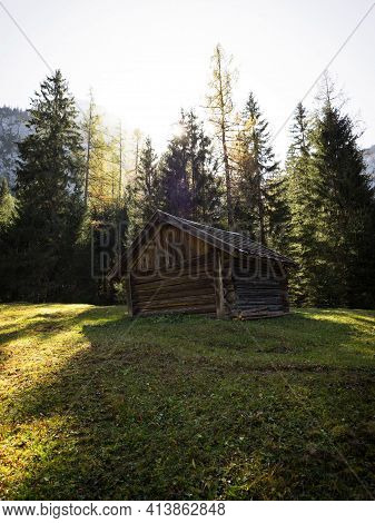 Autumn Fall Panorama Of Alpine Landscape Rustic Old Wooden Cabin Mountain Hut At Lake Seebensee In E