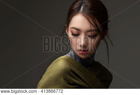 Beautiful Asian Woman In A Green Shawl. Beauty Of Mysterious Chinese Girl With Flowing Hair. Fashion