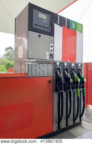 Gas Station With Filling Hoses Close Up