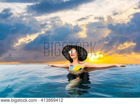 Portrait of happy woman at beautiful swimming pool. Maldives island. Travel and Vacation. Outdoor shot ( with clipping path )