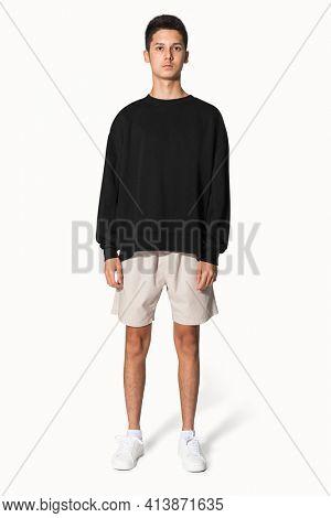 Teenage boy in black sweater winter apparel portrait
