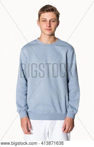 Teenage boy in blue sweater winter apparel portrait