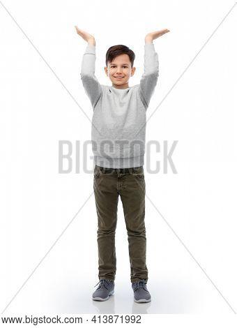 happy smiling boy holding something imaginary
