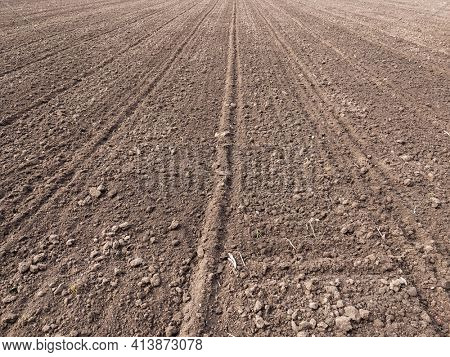 Arable land. Preparing field for planting. Plowed soil in spring time . Agricultural work.