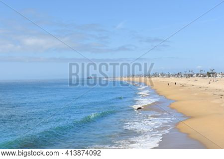 NEWPORT BEACH, CALIFORNIA - JANUARY 6, 2017: Newport Beach shoreline. With the Newport Pier in the background and seen from the Balboa Pier.