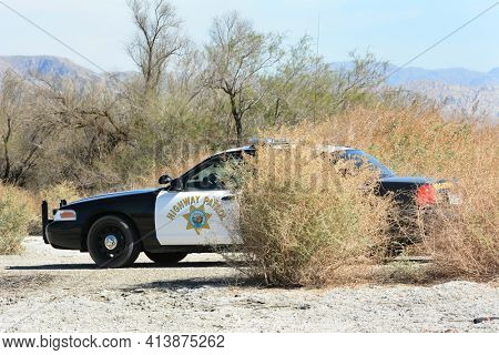 THERMAL, CA - FEBRUARY, 25, 2015: A California Highway Patrol Car in the desert. The CHP has patrol jurisdiction over all California highways and also acts as the state police.