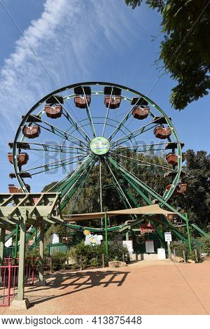 SANTA ANA, CALIFORNIA - 8 OCT 2020: 50 Monkeys Ferris Wheel at the Santa Ana Zoo. The ride is designed to spotlight the Santa Ana Zoo's Fifty Monkey heritage.