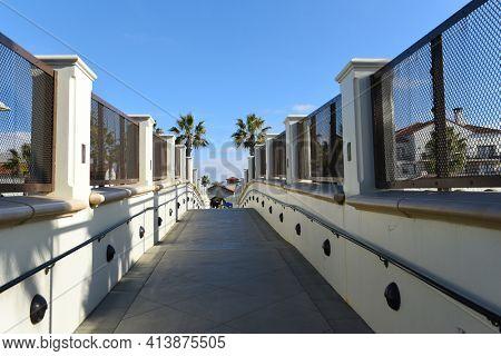 HUNTINGTON BEACH, CALIFORNIA - 22 JAN 2020: Hyatt Regency Hotel Pedestrian Bridge Spans the Coast Highway.
