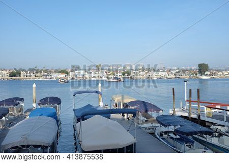 NEWPORT BEACH, CA - FEBRUARY 4, 2015: Two Balboa Ferry boats crossing the bay. The ferry's travel about 1000 feet from Balboa Island to the Balboa Peninsula docking about every 5 minutes.