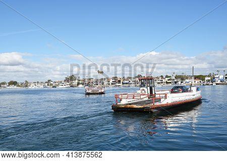 NEWPORT BEACH, CALIFORNIA - JANUARY 6, 2017: The Balboa Island Ferry. The ferry boats travel under 1,000 feet from Balboa Island to the Balboa Peninsula and vice versa.