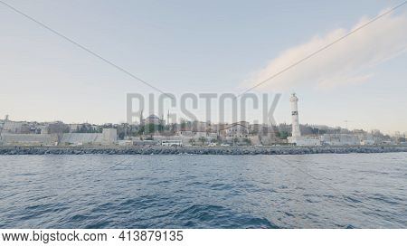 Sailing On Sea Boat With View Of Coast With City. Action. Beautiful Coast With City Is Visible From
