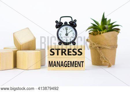 Stress Management Symbol. Wooden Blocks With Words 'stress Management'. Black Alarm Clock, Plant. Be
